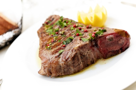 t bone: Florentine style steak with lemon on white Stock Photo