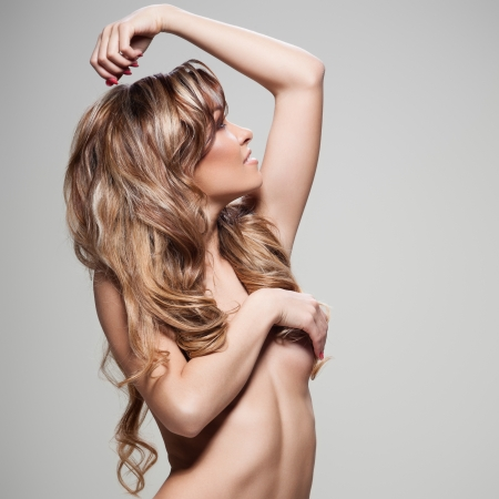 topless brunette: Young brunette lady with a beautiful hair on gray background Stock Photo