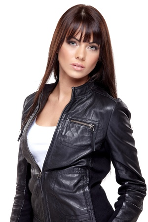 Glamorous young woman in black leather jacket on white background photo