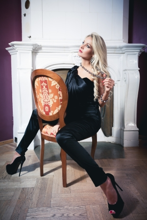 Beautiful blond woman in vintage interior Stock Photo - 17424744