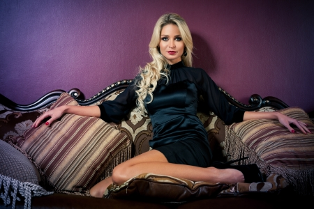 Beautiful blond woman in vintage interior Stock Photo - 17457368