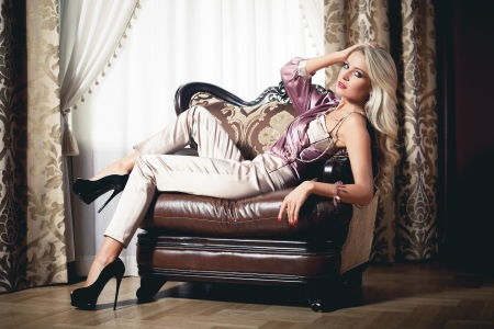 Beautiful blond woman in vintage interior photo