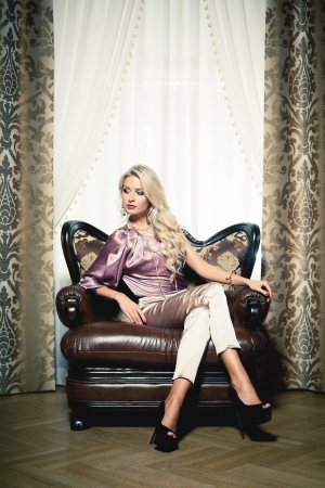 Beautiful blond woman in vintage interior