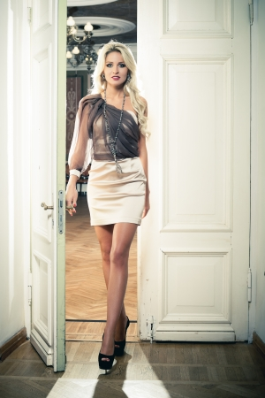 Beautiful blond woman in vintage interior Stock Photo - 17501684