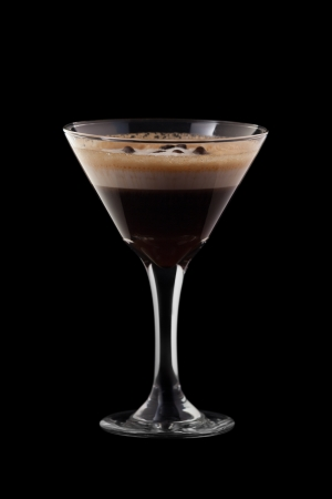 sour cream: Espresso-Absinthe coctail isolated on black background Stock Photo
