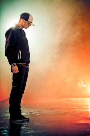 hip hop man: Teenage brakedancer boy standing in a smoke