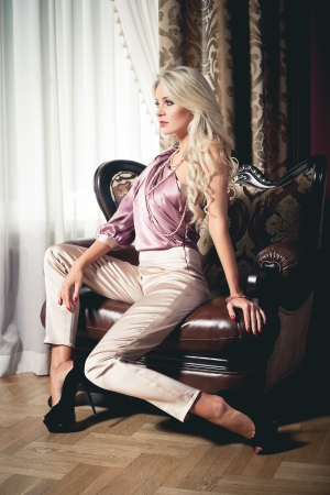 Beautiful blond woman in vintage interior Stock Photo - 17547409
