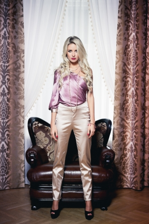 Beautiful blond woman in vintage interior Stock Photo - 17547410