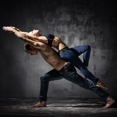 Man and woman in passionate dance pose photo