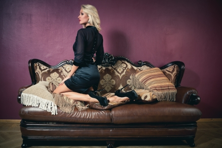 Beautiful blond woman in vintage interior Stock Photo - 17547416