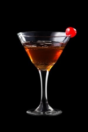 daniels: Apple manhattan coctail isolated on black background