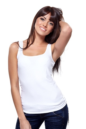 Glamorous young woman in white shirt on white background photo