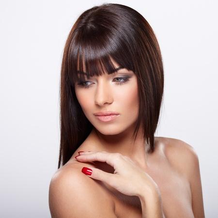 Portrait of beautiful female model on grey background Stock Photo - 17566287