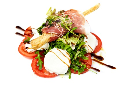 ruccola: Caprese salad with ruccola and Parma ham Stock Photo
