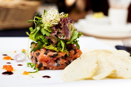 tartar: Salmon tartar with red caviar and ginger croutons