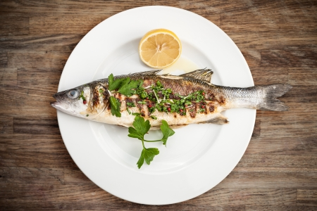Grilled sea bass on a plate