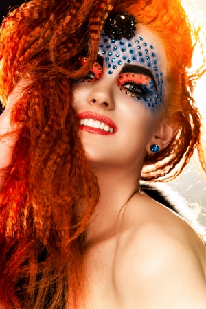 Vogue style portrait of a woman with creative makeup photo