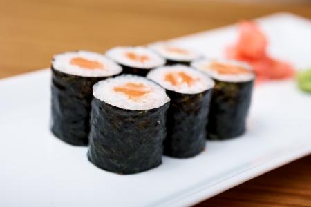 maki: Salmon hosoroll served on a plate Stock Photo