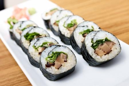 shiitake: Rolls with shiitake mushrooms served on a plate Stock Photo