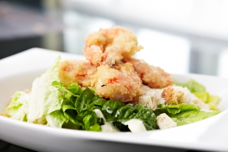 Classical Caesar salad with tempura shrimp photo