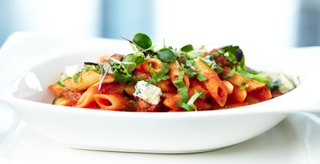 Tomato pasta with beef, mushrooms and blue cheese Bleu d Auvergne photo