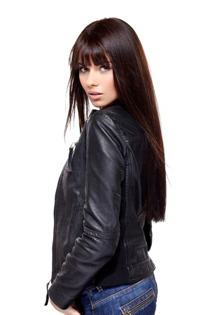 back straight: Glamorous young woman in black leather jacket on white background