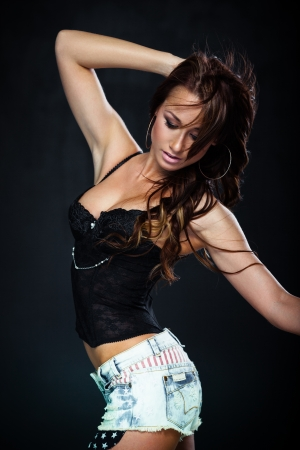 babe: Sexy woman dancing on dark background Stock Photo