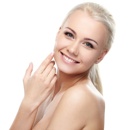 Young blond lady with a beautiful hair on white background