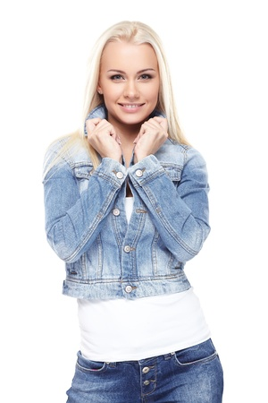 denim jacket: Young sexy blond woman in jeans jacket isolated on white