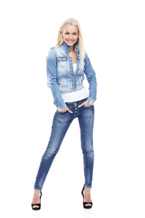 Young sexy blond woman in jeans jacket isolated on white