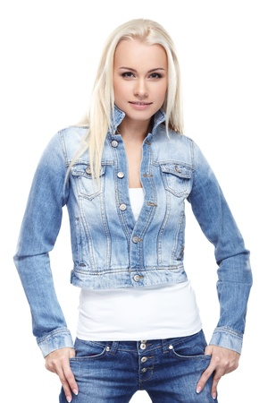 jeans girl: Young sexy blond woman in jeans jacket isolated on white