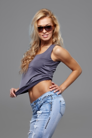 shades of grey: Sexy woman in sunglasses posing