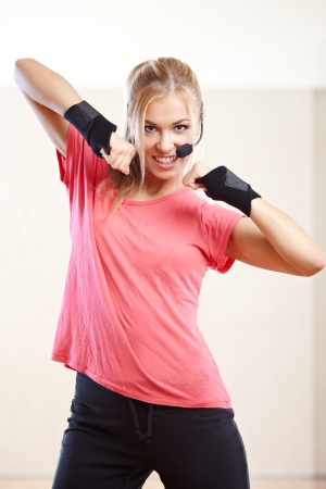 Smiling female fitness instructor in a gym Standard-Bild