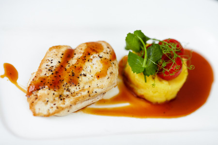 Savoury chicken with mashed potatoes and French orange sauce photo