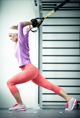 personal trainer woman: Young woman streching muscles functional training