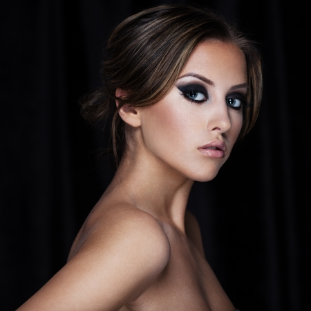 Closeup portrait of a beautiful lady on black photo