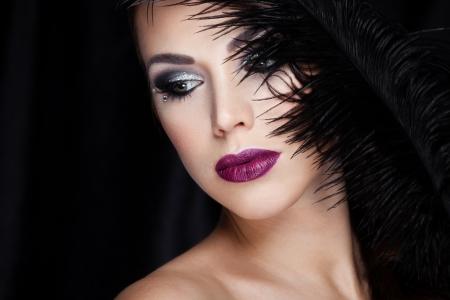 Closeup portrait of a beautiful lady on black 写真素材