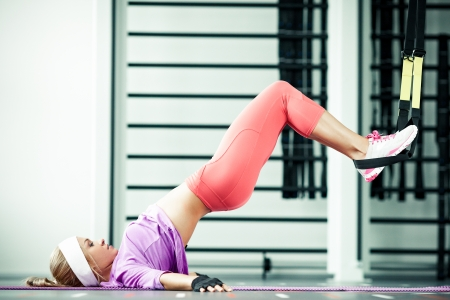 Young woman streching muscles functional training photo