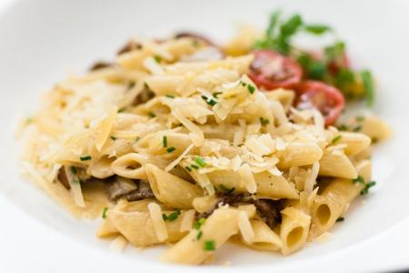 Pasta with porcini and chanterelle mushrooms in light cream sauce photo