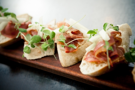 breakfast food: Bruschetta with parma ham and melon