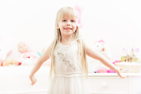 Little adorable girl spreading hands wide ready to hug photo