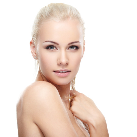 Young blond lady on white background photo