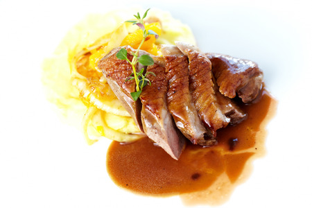 Roasted duck with mashed potatoes, caramelized fennel and orange salad and white wine sauce photo