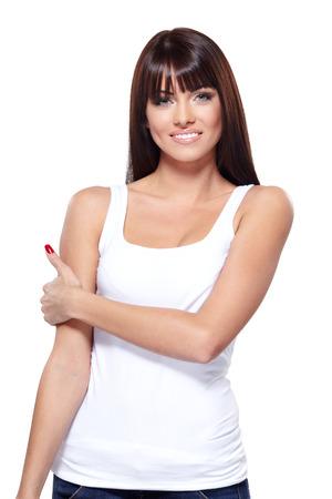 Glamorous young woman in white shirt on white  photo
