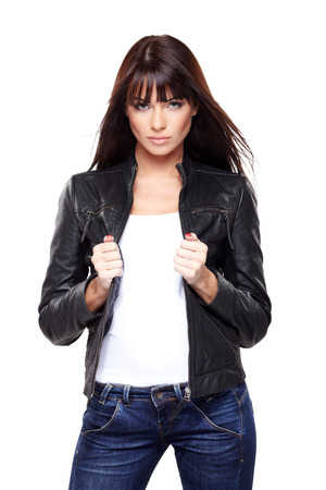Glamorous young woman in black leather jacket on white  Stock Photo