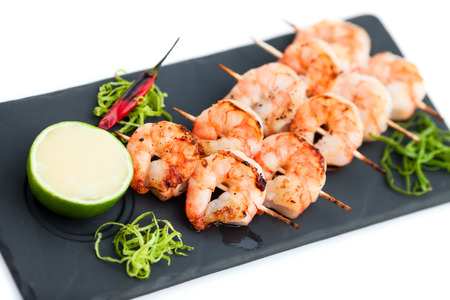 Skewered prawns (yakitori) with sauce isolated on white Standard-Bild