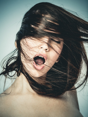 Portrait of a young woman shouting in ecstasy photo