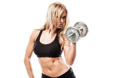 body builder: Smiling athletic woman pumping up muscles with dumbbells on white background