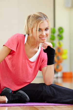 instructor: Smiling female fitness instructor in a gym Stock Photo
