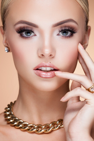 sexy style: Young lady with luxury accessories on beige background